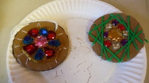 Cardboard ornaments were jazzed up with colored string, glitter glue, and bling.