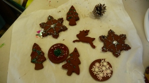 Cinnamon ornaments  made with cinnamon, apple sauce and glue.  the cinnamon dough smelled wonderful and was  a new texture to experience working with.